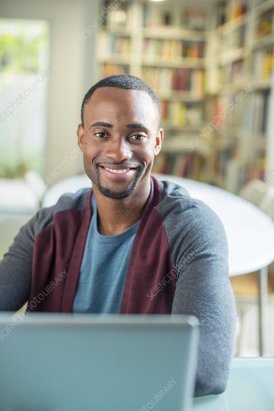 Portrait of smiling man at laptop