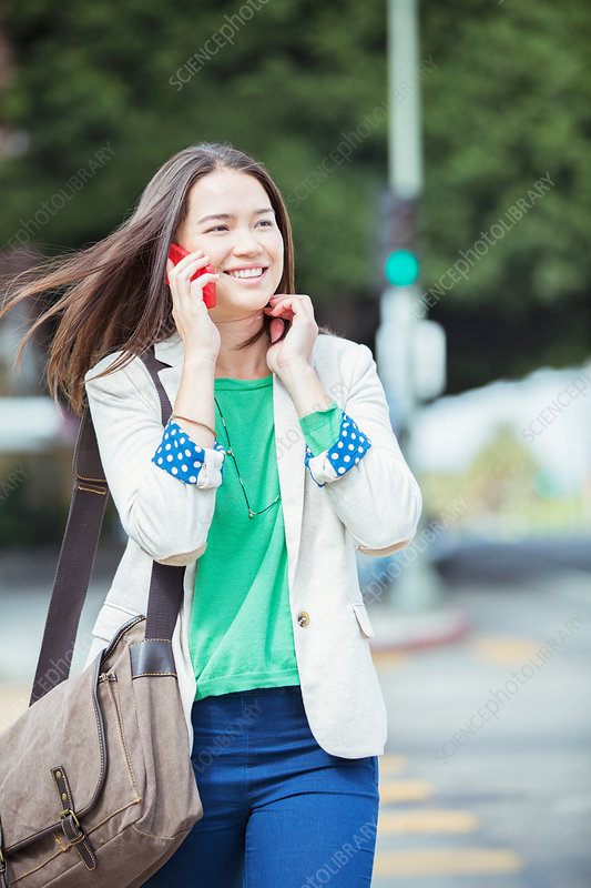 Happy businesswoman talking in crosswalk