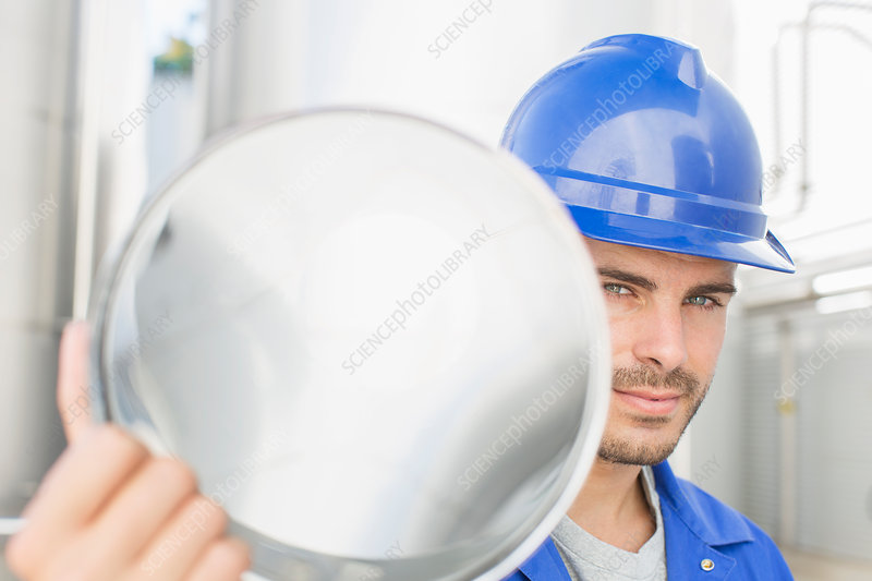 Worker holding stainless steel tube