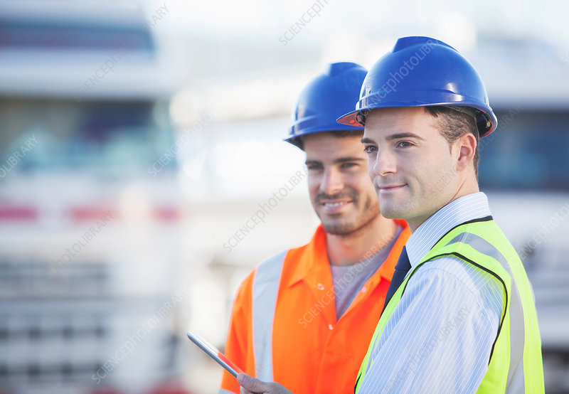 Businessman and worker using tablet