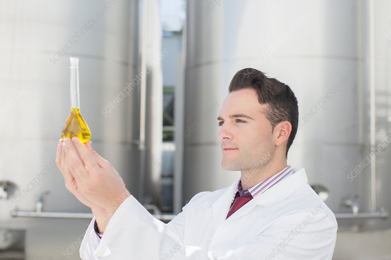 Scientist examining liquid in beaker
