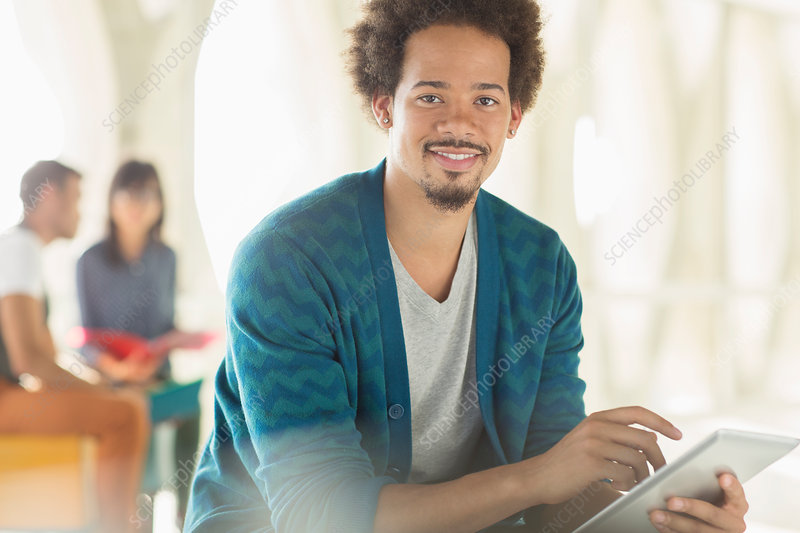 Casual businessman using tablet