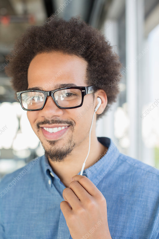 Portrait of man using hands-free device