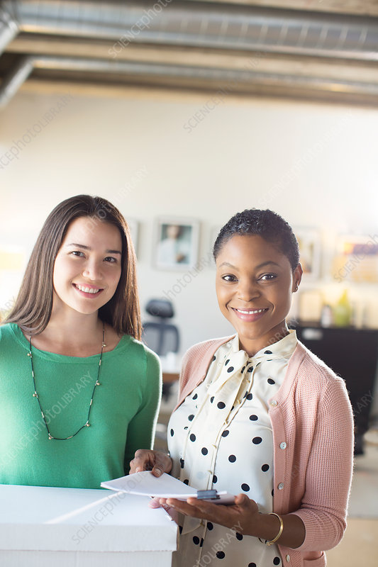 Smiling businesswomen in office