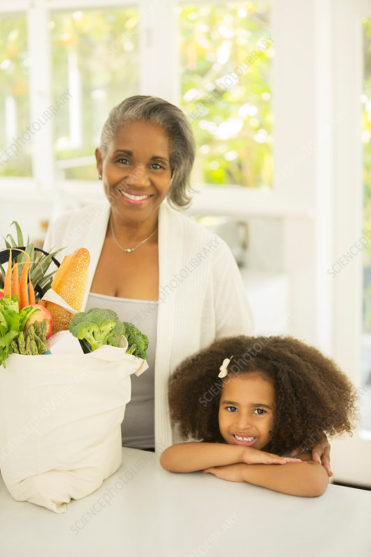 Grandmother and grandchild with groceries