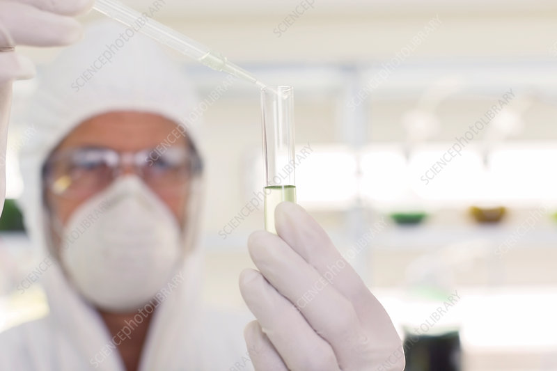 Scientist using pipette and test tube