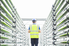Engineer among irrigation pipes
