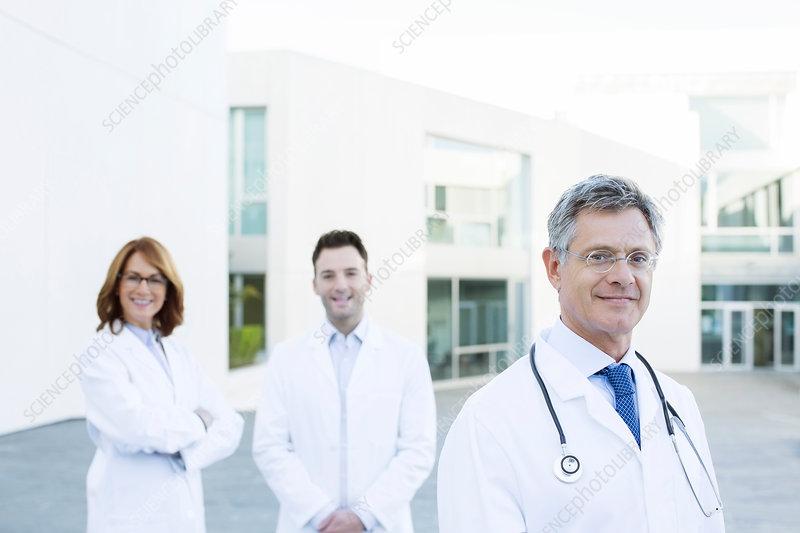 Portrait of confident doctors on rooftop