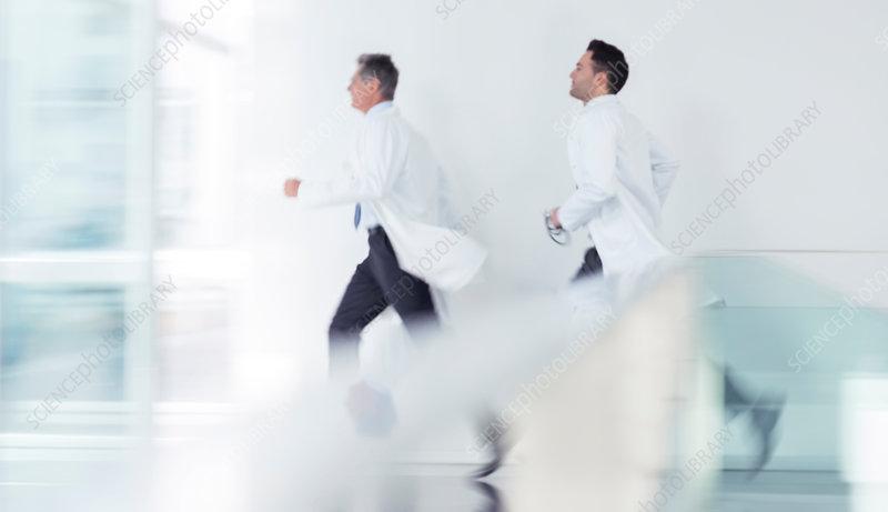 Doctors running in hospital corridor
