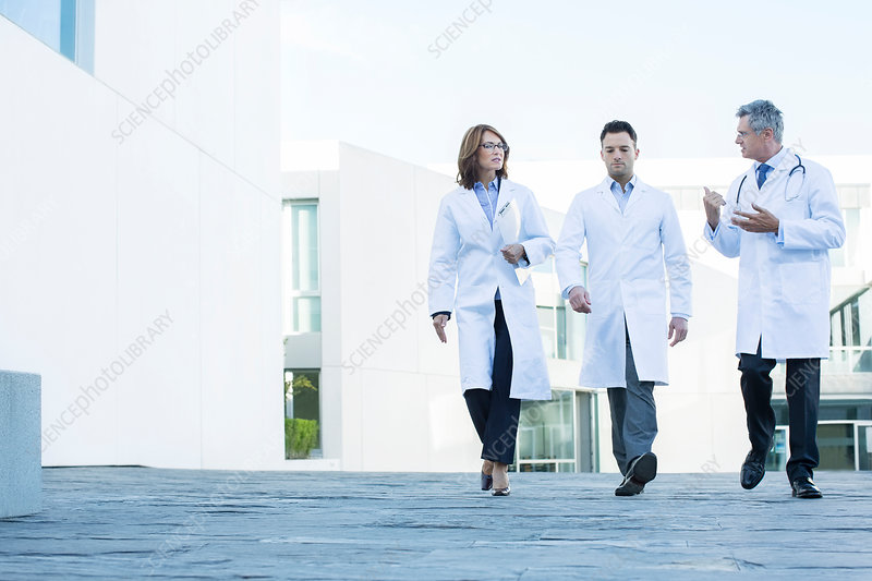 Doctors walking and talking on roof