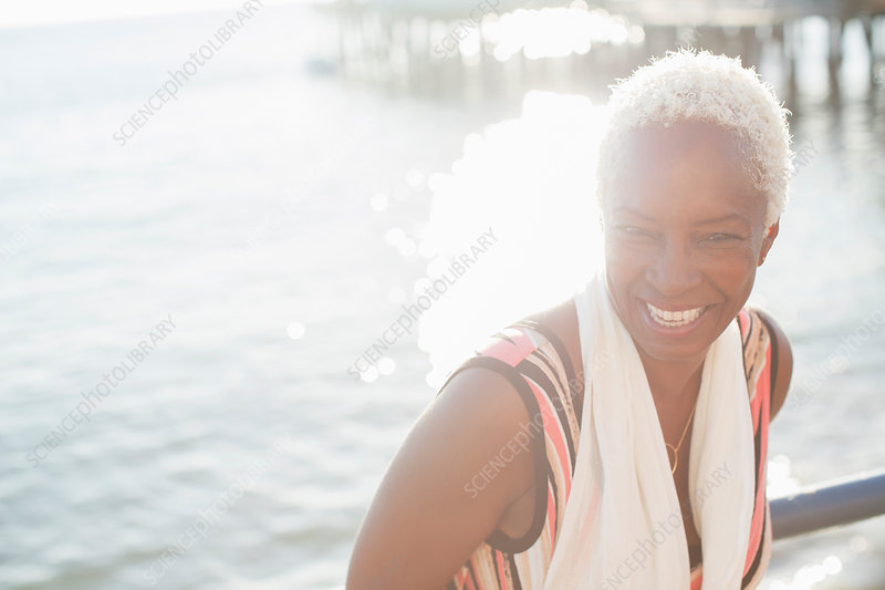 Portrait of smiling woman at oceanfront