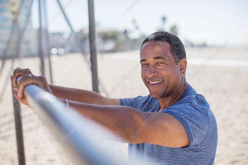 Senior man leaning on bar
