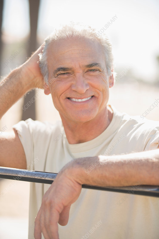 Portrait of smiling senior man outdoors