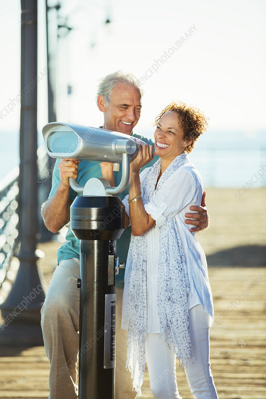 Couple using coin-operated binoculars