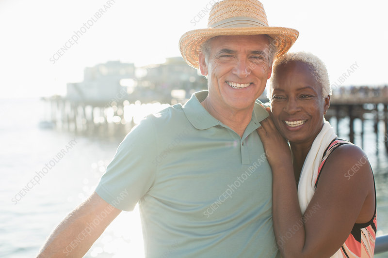 Portrait of happy senior couple on beach