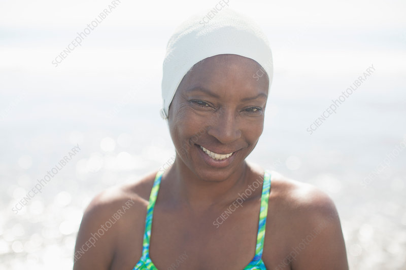 Woman in swimming cap at beach