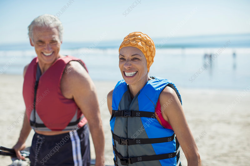 Enthusiastic couple in life jackets