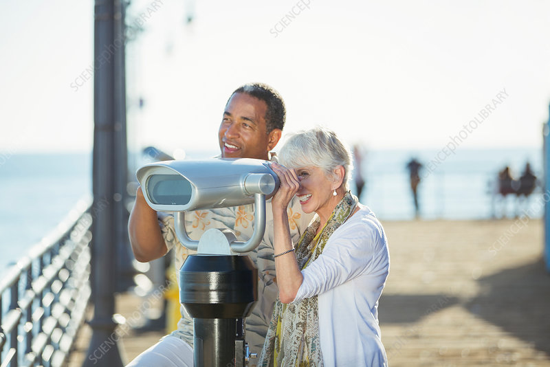 Senior couple using binoculars