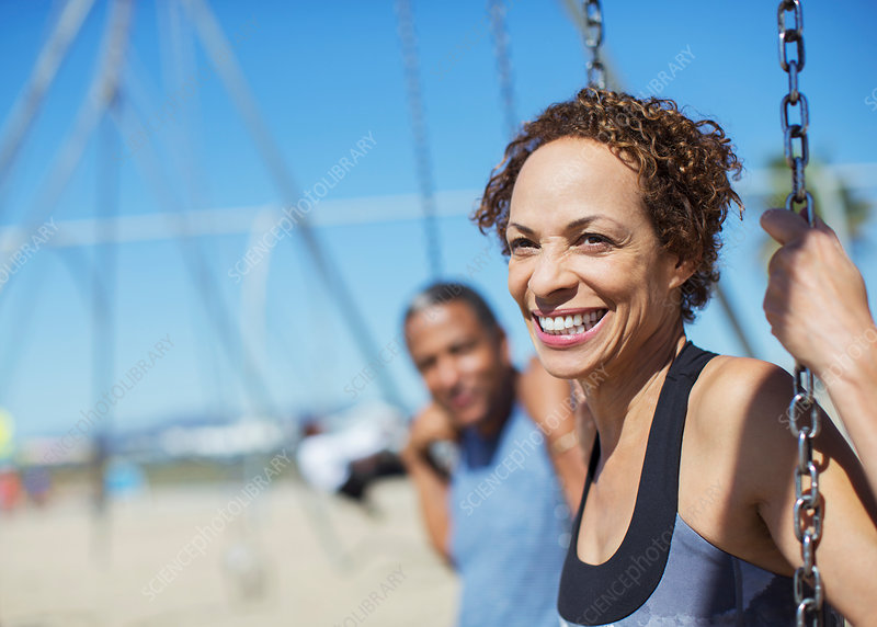Happy couple on swings at playground