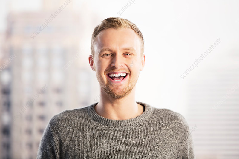 Portrait of laughing businessman
