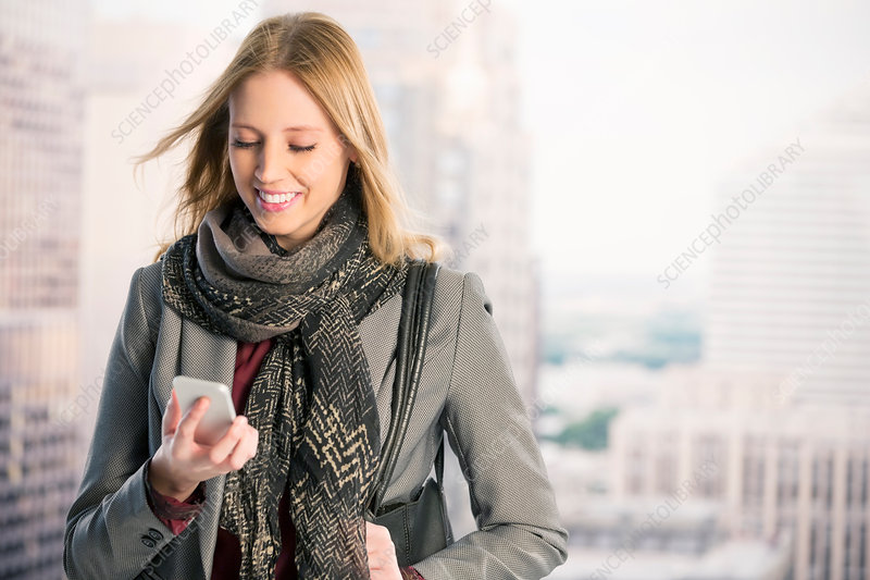 Smiling businesswoman using cell phone