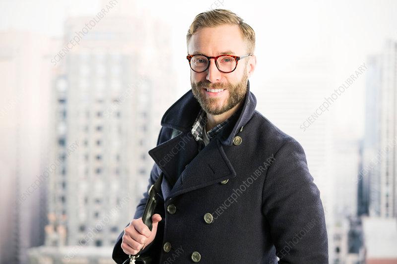 Smiling businessman in urban window