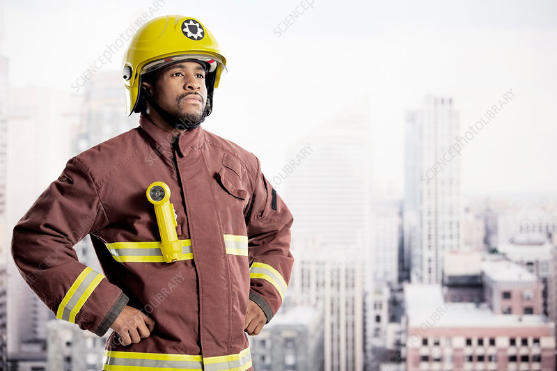 Confident fireman in urban window