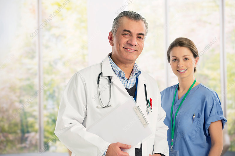 Portrait of confident doctor and nurse