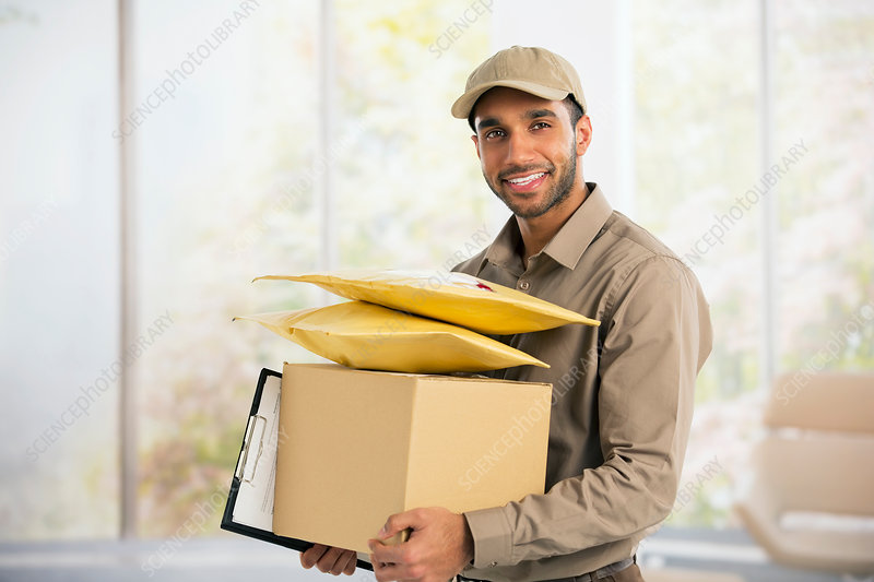 Portrait of confident deliveryman
