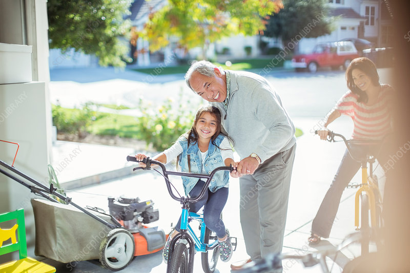 Grandfather and granddaughter on bike
