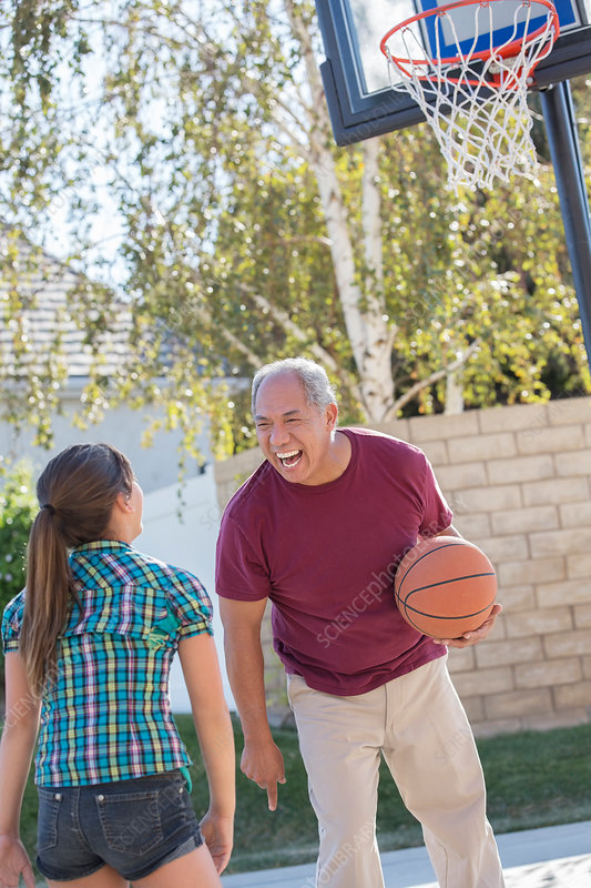 Grandfather and granddaughter playing