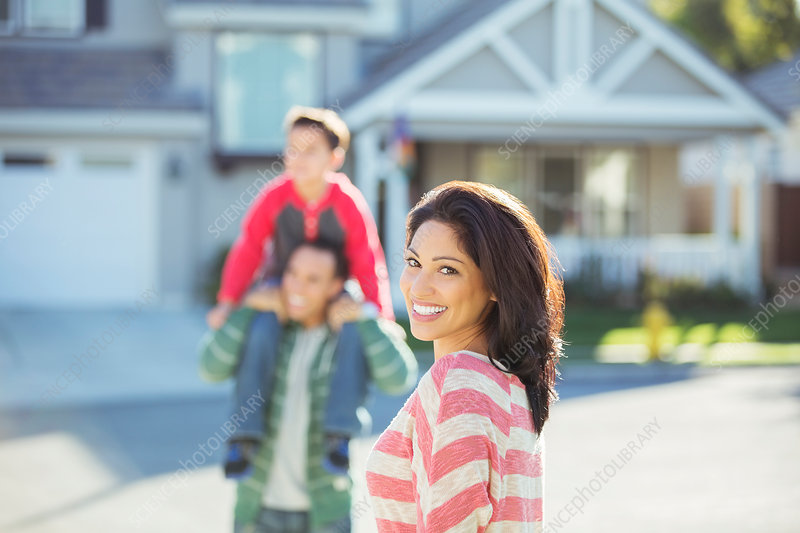 Woman with family on street