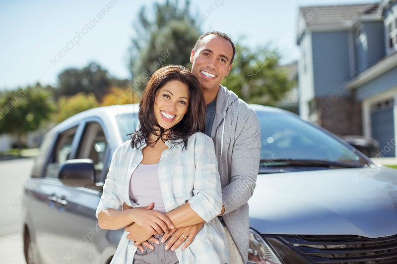 Portrait of smiling couple in driveway