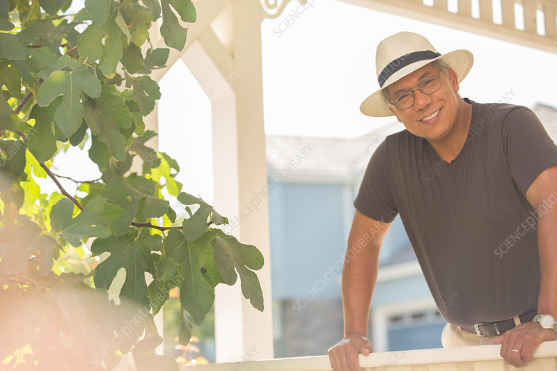 Portrait of smiling man on sunny porch