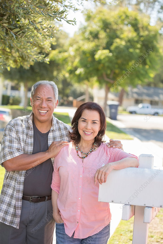 Portrait of smiling couple at mailbox