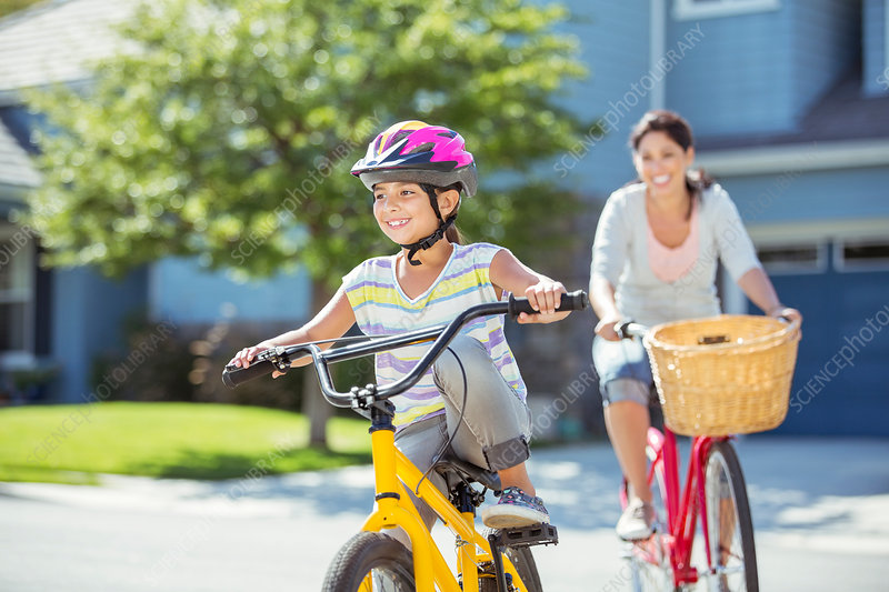 Mother and daughter riding bicycles