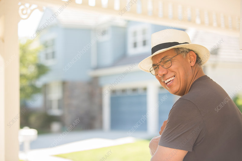 Laughing man on sunny porch