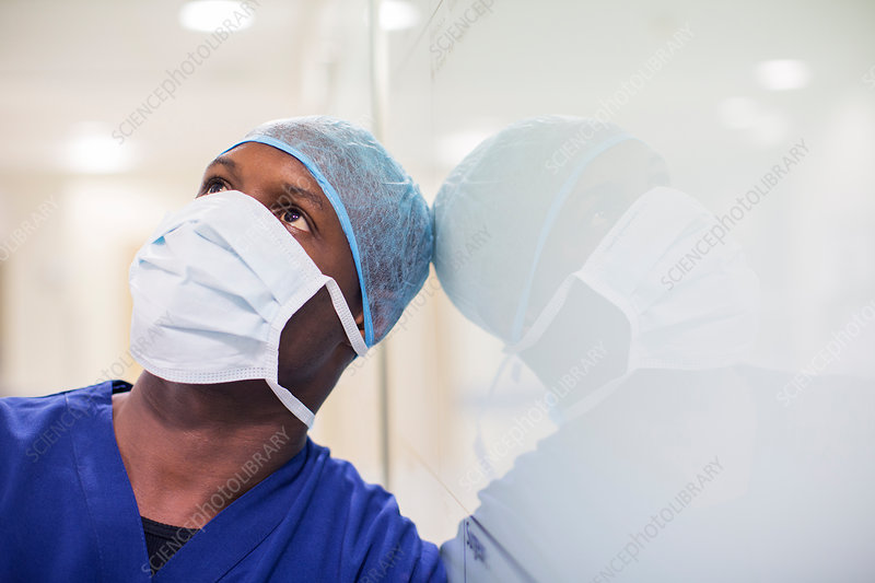 Portrait of mid adult surgeon in hospital
