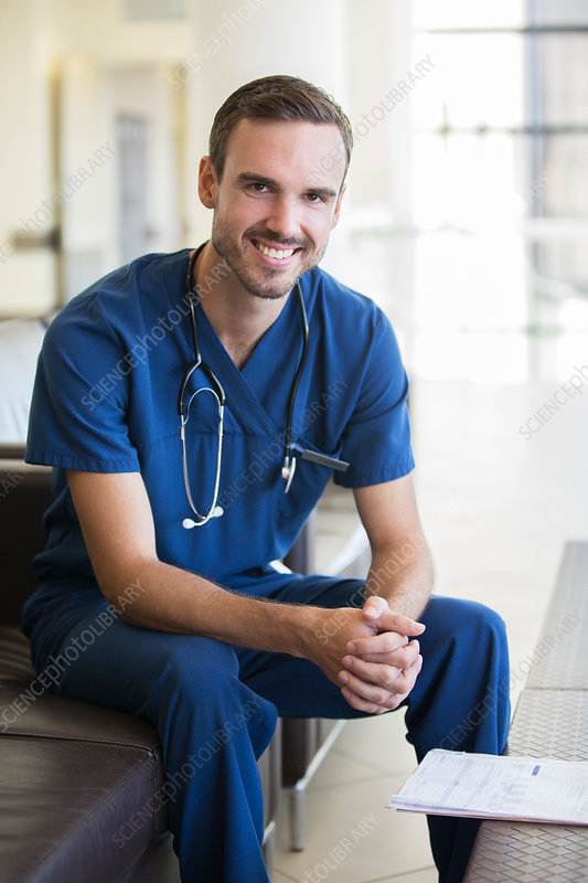 Portrait of male doctor sitting