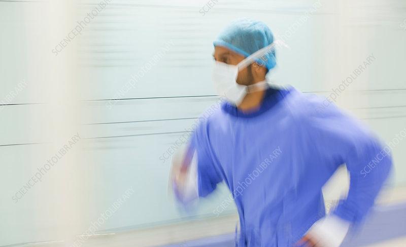 Male surgeon rushing