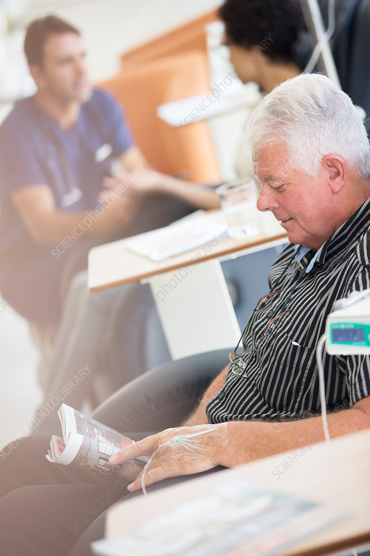 Senior man receiving intravenous infusion
