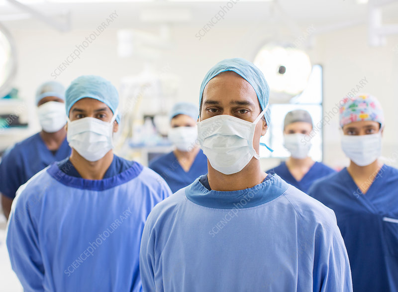 Group portrait of team of masked surgeons