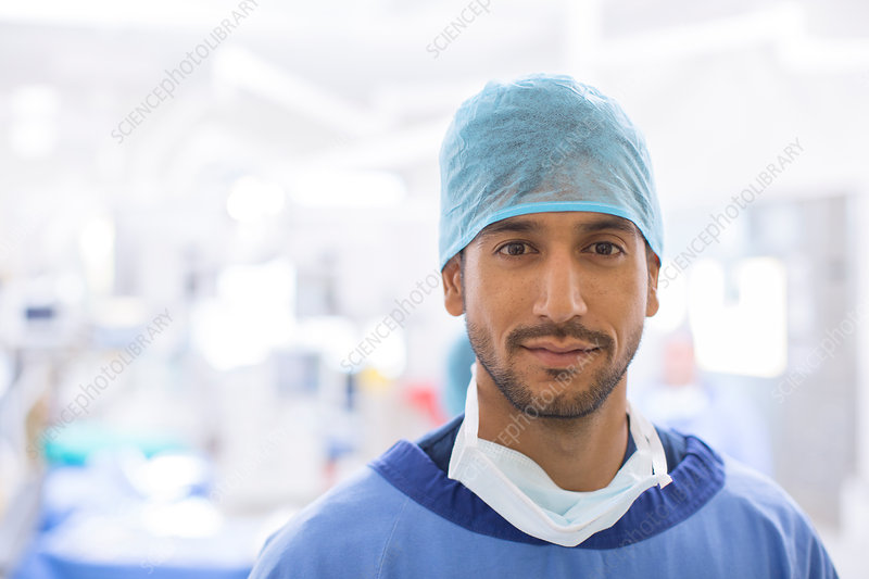 Portrait of male surgeon wearing hair net