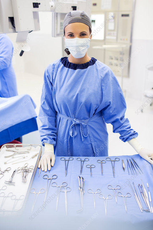 Surgical nurse behind medical tools