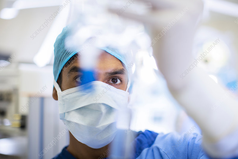 Surgeon wearing surgical mask