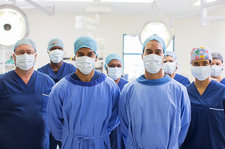 Team of surgeons in operating theatre