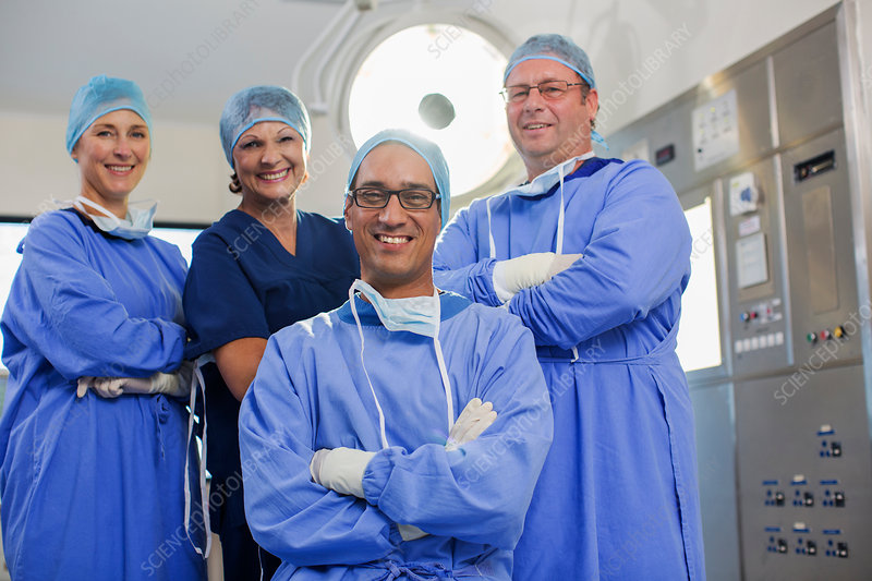 Team of doctors wearing surgical clothing