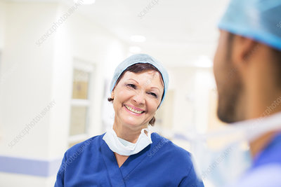 Doctors wearing surgical caps