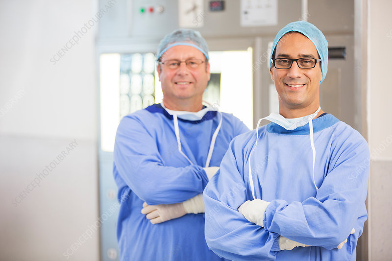Two smiling doctors with arms crossed