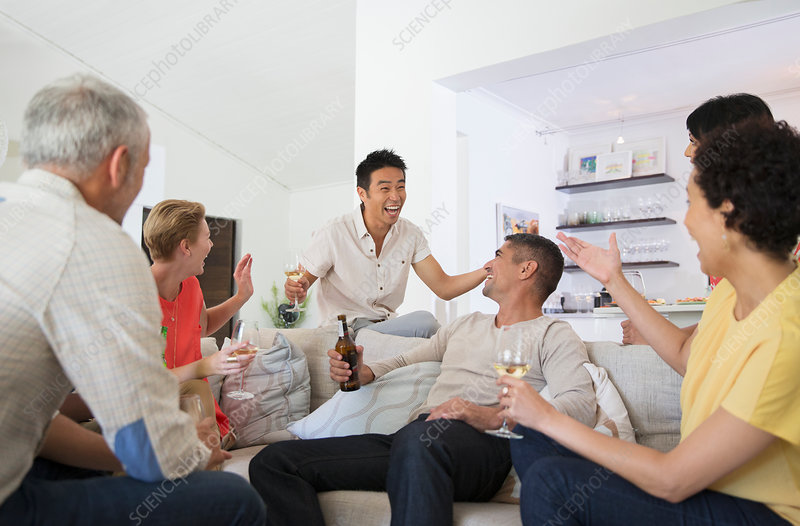 Friends cheering at party